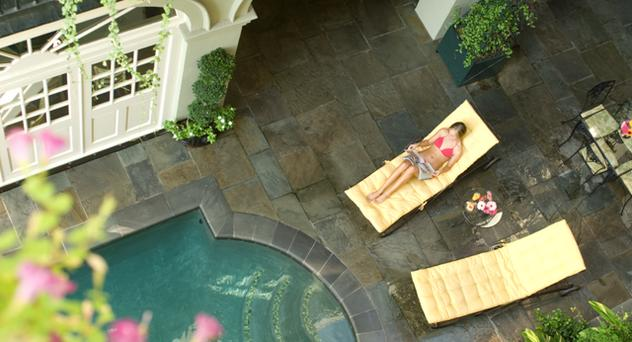 Relax by the pool during summer, when Bienville House offers special rates.