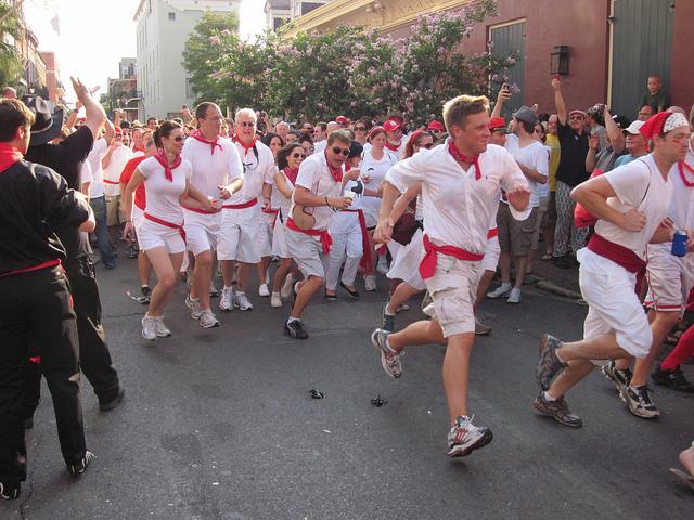 To mimic the original Spanish festival, runners at San Fermin in Nueva Orleans are required to wear white and red. (Photo courtesy Infrogmation)