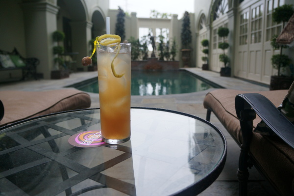 Enjoy sipping a tiki cocktail from Latitude 29 (like the Mississippi Mermaid pictured here) while overlooking our French Quarter courtyard pool at Bienville House.