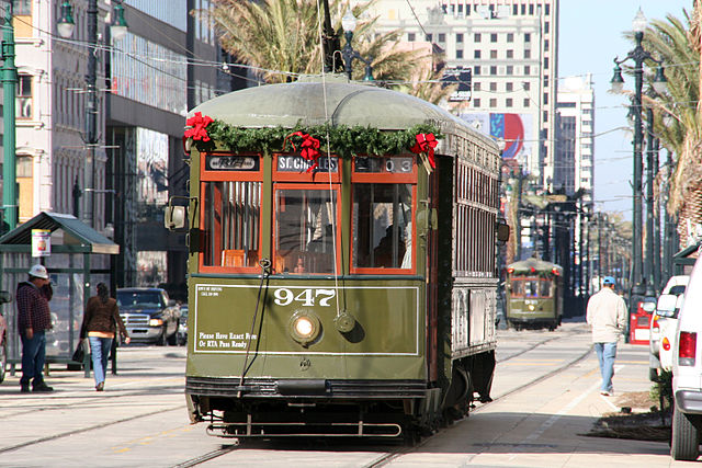 Canal streetcars adorned with holiday decorations.