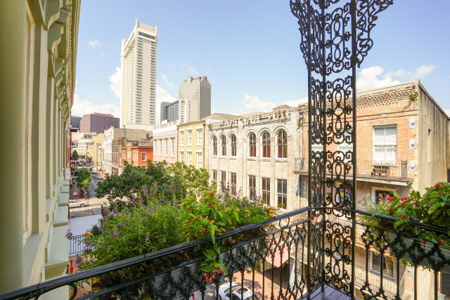 Enjoy the view from your French Quarter balcony when you stay at Bienville House this summer.