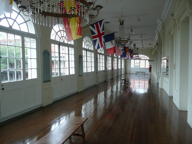 The gallery inside of the historic Cabildo displays the flags of those who have ruled in New Orleans. (Photo via Flickr user Tom Bastin)
