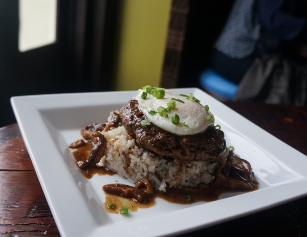 Latitude 29's the Loco Moco. 8 ounce beef patty, shiitake mushrooms, coconut rice, and a fried egg.