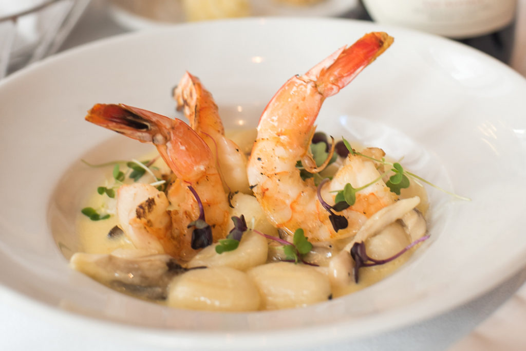 Grilled Jumbo Gulf Shrimp at Criollo made with Porcini Mushroom Gnocchi, Garlic Cognac Sauce