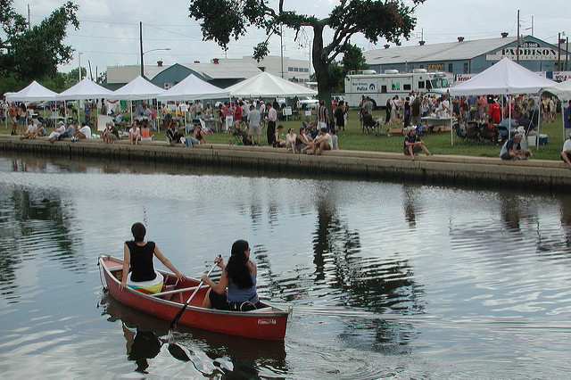 Canoeing on Bayou St. John during Bayou Boogaloo Music Festival.