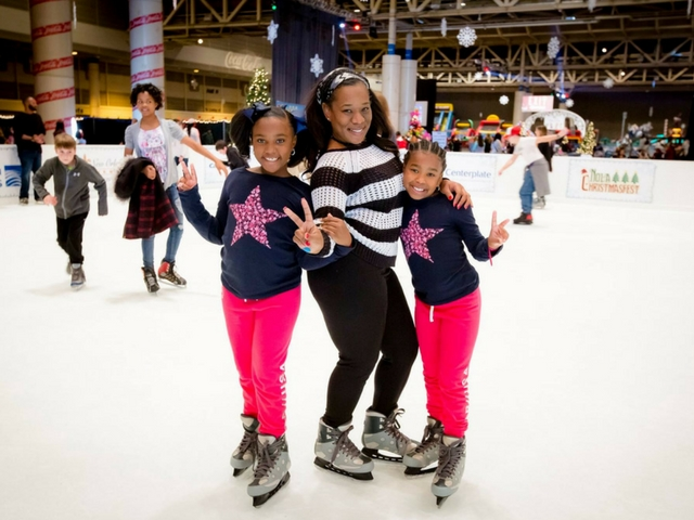 Skaters at ChristmasFest's full-sized ice rink.