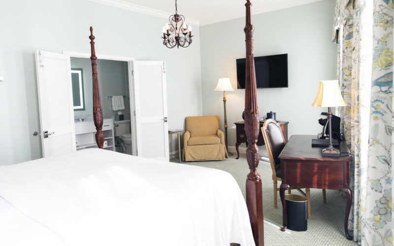 Renovated Bienville House Hotel guest rooms feature wall-mounted televisions.